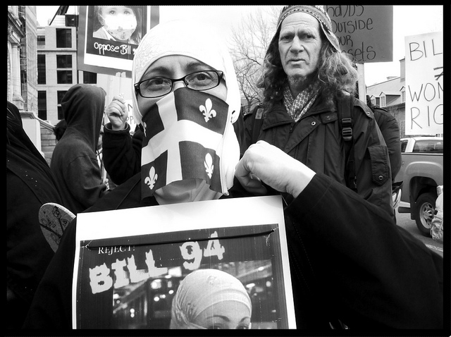 Muslim woman and Jewish man against Bill 94, 2010