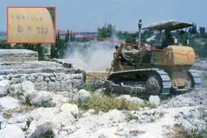 Those letters are the Hebrew acronym for Jewish National Fund. This JNF bulldozer is destroying a village structure in Imwas.